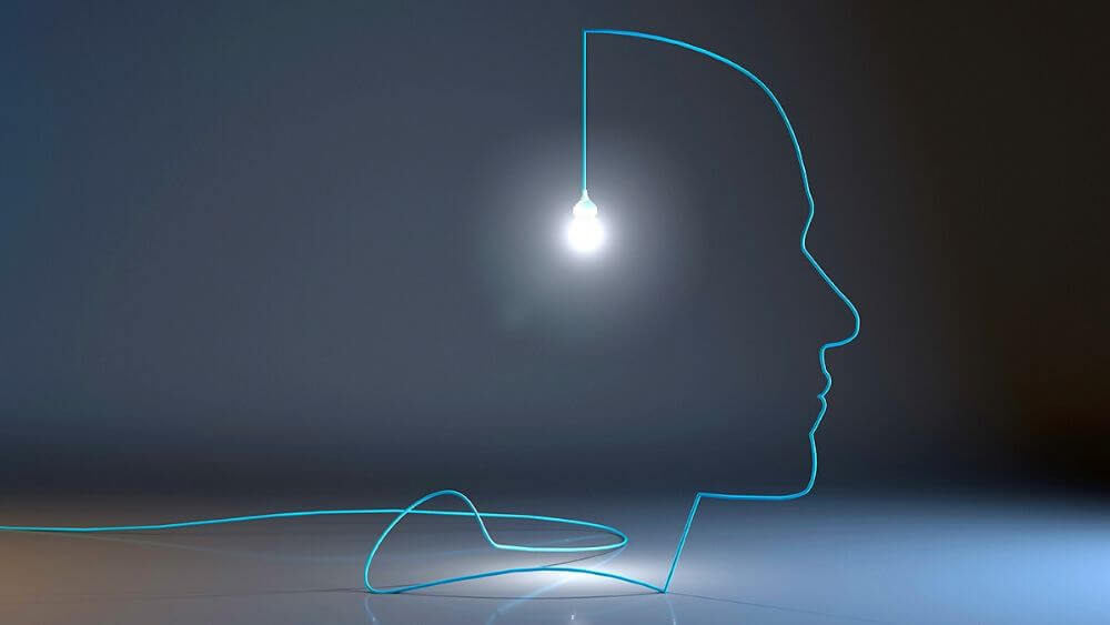Blue Data Cable Making Outline of Face with Lightbulb